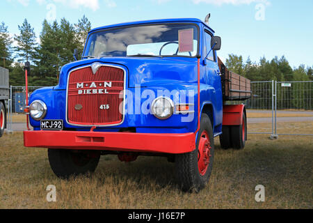 HYVINKAA, FINLAND – SEPTEMBER 11, 2015: Nostalgic Blue and red MAN 415 L1A 4x4 truck year 1961 on display at MAXPO - Stock Photo