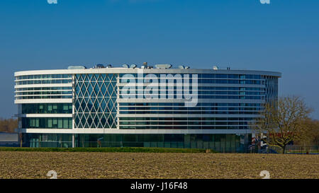 Modern architecture in a rural environment, the Barco building in Courtrai, Flanders, Belgium - Stock Photo