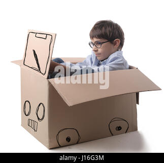 Little boy in imaginary car - Stock Photo