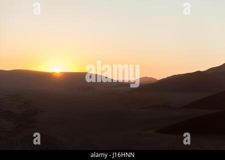 Sunrise seen from Dune 45, Sossusvlei in the Namib in Namibia, Africa - Stock Photo