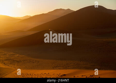 Sunrise seen from Dune 45, Sossusvlei, Namib, Namibia, Africa - Stock Photo