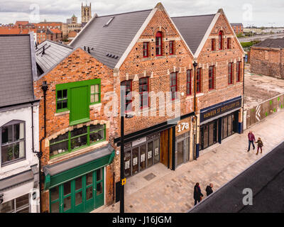 Humber Street, Fruit Market urban regeneration area in Hull dock area with Holy Trinity Church clock tower in distance, - Stock Photo