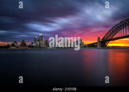 Sunset skyline of Sydney downtown  with Harbour Bridge, NSW, Australia. Long exposure. - Stock Photo