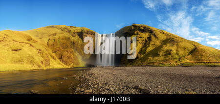 Panorama of the famous Skogafoss waterfall in southern Iceland. Long exposure. - Stock Photo