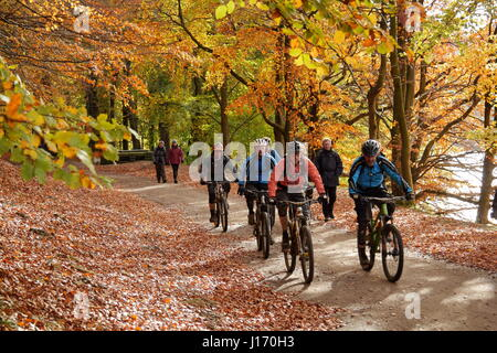Cyclists on the Upper Derwent Valley reservoirs circuit in autumn, Peak District National Park, Derbyshire EnglandUK - Stock Photo