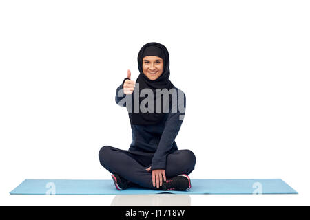 muslim woman doing sport and showing thumbs up - Stock Photo