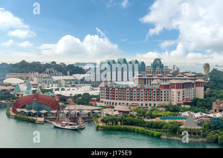 SINGAPORE - 26 February, 2017 : Tourists and theme park visitors taking pictures of the large rotating globe fountain - Stock Photo