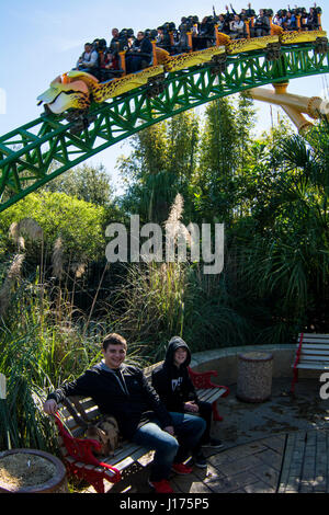 theme park people on rides and coasters - Stock Photo