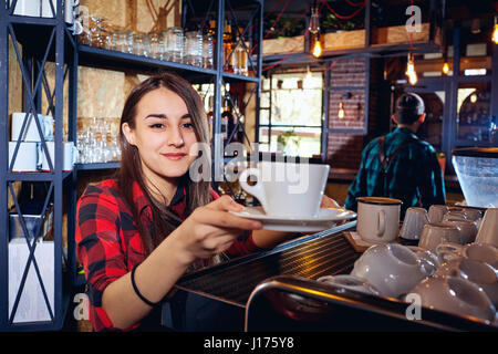 The barman girl works at bar in  restaurant - Stock Photo
