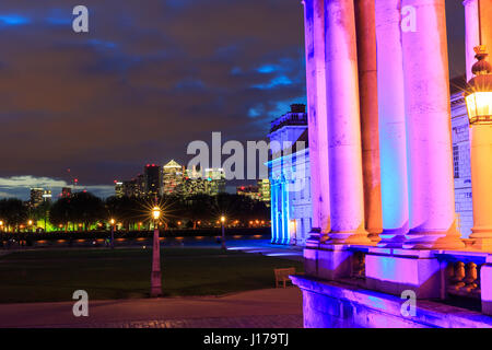 Greenwich, London, UK, 18th April 2017. The illuminated ORNC with Canary Wharf in the background. For the first - Stock Photo