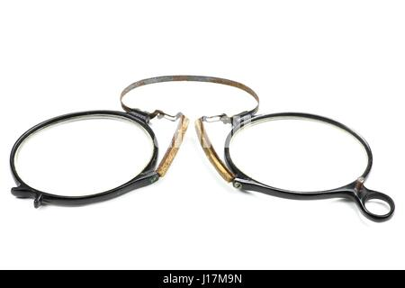antique pince-nez isolated on white background - Stock Photo