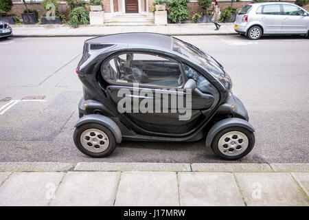 Renault Twizy small electric vehicle / car parked on a London street, UK - Stock Photo