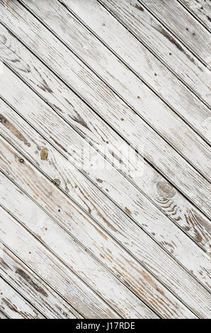 Old wooden gate is covered with shabby white paint. Texture. Oblique lines. - Stock Photo