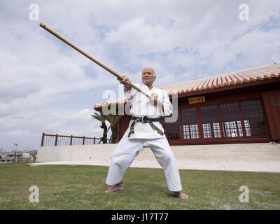 Karate master Arakaki sensei at the 100 Kobudo Kata Event at Karate Kaikan, Okinawa, Japan - Stock Photo