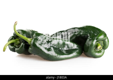 Three whole poblano peppers on white background with shadow. - Stock Photo