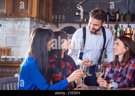 Group of friends are party having fun chatting with glasses of  - Stock Photo