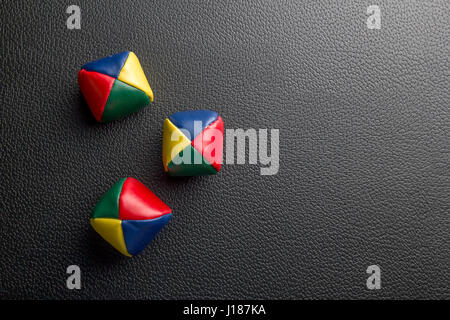 Colored balls over a black table - Stock Photo