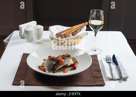 Grilled fish with roasted potatoes - Stock Photo