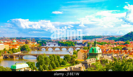 Panorama view of Prague skyline with Charles bridge and Vltava river in the late afternoon summer - Stock Photo