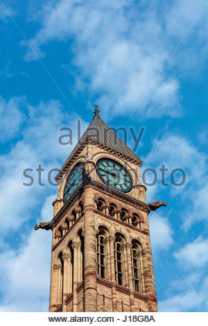 clock tower ornamental stonework on Toronto old city hall a National Historic Site in Romanesque Revival by E J - Stock Photo