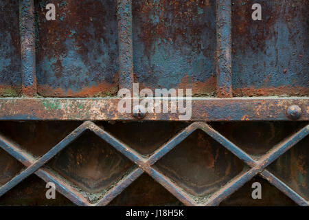 Fragment of old metal rusty gate painted blue. Architectural detail, Toulouse, France. - Stock Photo