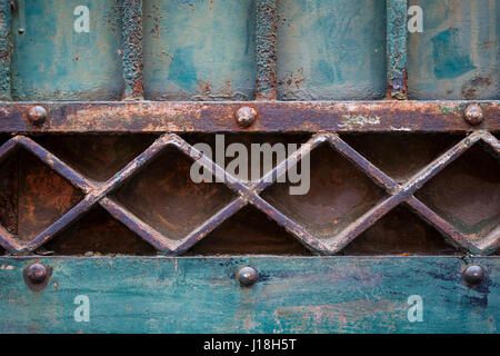 Fragment of old metal rusty gate painted blue. Architectural geometric detail, Toulouse, France. - Stock Photo