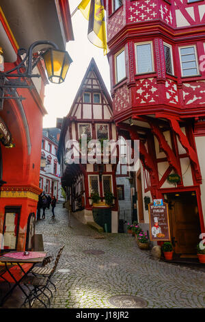 Bernkastel-Kues, Germany - November 01, 2016: unique half-timbered buildings with unidentified people. Bernkastel - Stock Photo
