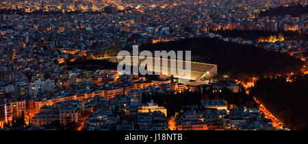Panathinaiko stadium in Athens, Greece at night - Stock Photo