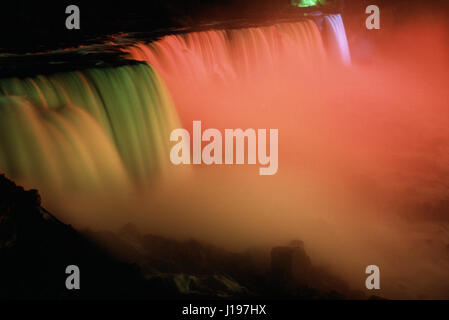 Niagara Falls illuminated and viewed from the American side, New York State, USA - Stock Photo