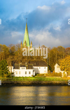 Trondheim Cathedral, seen from across the river Nidelva, Trondheim, Norway - Stock Photo