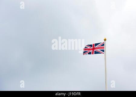 Union jack flag flying over Buckingham Palace. City of Westminster, London, England - Stock Photo