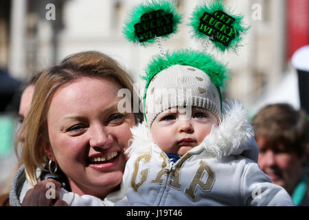 Hundreds of people attend the annual St Patrick's Day celebrations in Trafalgar Square, London  Featuring: Atmosphere - Stock Photo