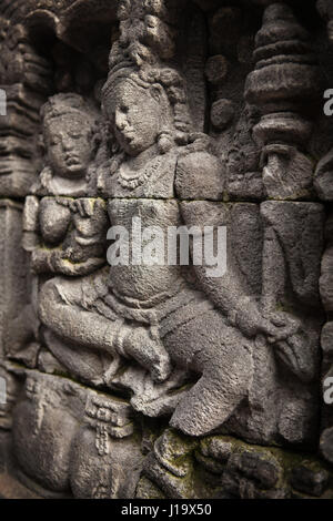 A detail of the stone carvings on the Borobudur in Indonesia, Asia. - Stock Photo