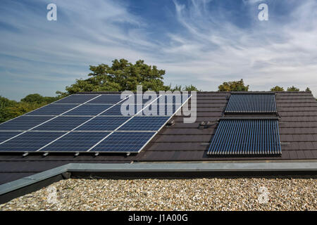 Solar panels on garage roof. Weberhaus - Modular House, NA, United Kingdom. Architect: Weberhaus, 2017. - Stock Photo