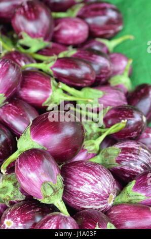 Pile of selected fresh eggplants for sale in a market - Stock Photo