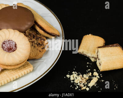 Selection of Teatime Biscuit Snacks Served on a Plate - Stock Photo