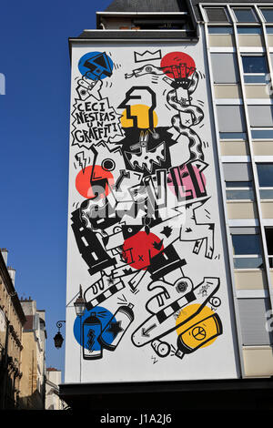 Colorful design on wall in Paris, France - Stock Photo