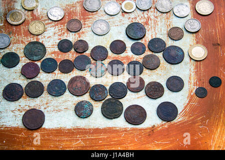 Old coins on scratched background. Selective focus. - Stock Photo
