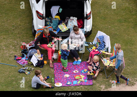 Family picnic in Carding Mill Valley in Shropshire Uk - Stock Photo