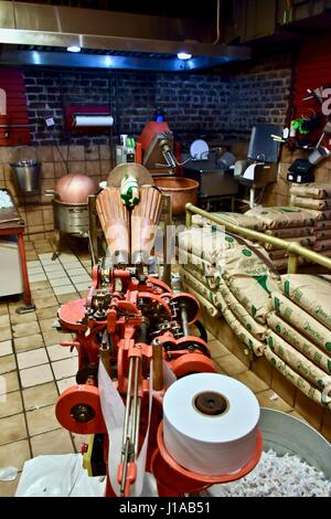 Salt water taffy machine at the Savannah Candy kitchen Stock Photo ...