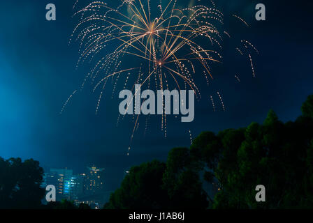 Fire works over the city of Adelaide's CBD, South Australia on New Years Eve from Montefiore Hill by the Lights - Stock Photo