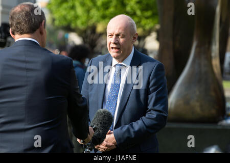 London, UK. 19th April, 2017. Damian Green MP, Work and Pensions Secretary, is interviewed on College Green following - Stock Photo