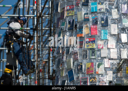 Kassel, Germany. 20th Apr, 2017. Books wrapped in plastic hang on the steel scaffolding of the documenta artwork - Stock Photo