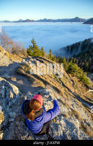 A young runner enjoys the views from the top of the Nockstein mountain in Salzburg, Austria. - Stock Photo