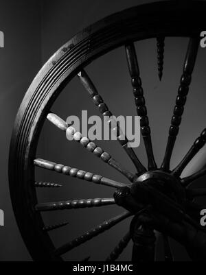 Vintage norwegain spinning wheel for spinning thread or yarn from natural or synthetic fibres - Stock Photo