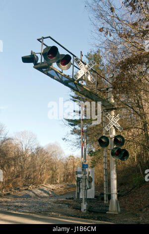 An old North Carolina railroad crossing with warning lights and crossed signs on an autumn day - Stock Photo