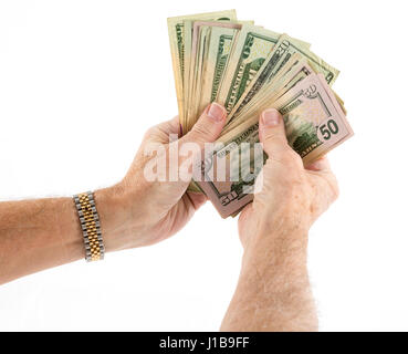 Holding a fan of money - fifty and twenty US dollar bills bank notes - Stock Photo