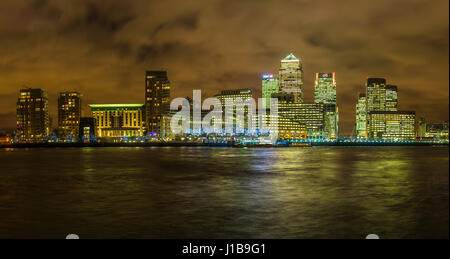 Night time London skyline shot of the office buildings in Canary Wharf, Docklands, London, England - Stock Photo