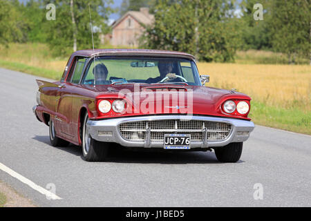 ... SOMERO, FINLAND   AUGUST 6, 2016: Red Thunderbird Hardtop 1960 Classic  Car Takes