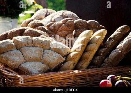 Various types of bread in a basket - Stock Photo